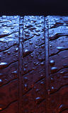 Wet tire. With red and blue lights Stock Photo