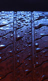 Wet tire or tyre. Wet tyre or tyre with red and blue lights Stock Photography