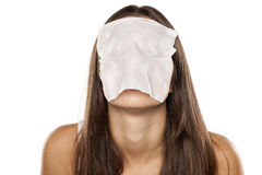 Wet tissue over her face Royalty Free Stock Photo