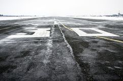 Wet to the airport in cloudy weather in winter. Wet to the airport in cloudy weather in winter Royalty Free Stock Photo