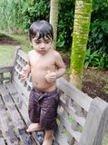 Wet toddler boy standing after playing with water Royalty Free Stock Photos