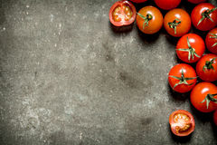 Wet tomatoes on stone table. Royalty Free Stock Image