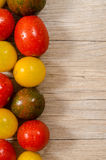 Wet tomatoes with text space on wood Stock Photos