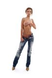 Wet topless girl in blue jeans Stock Image