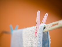 Wet towel drying on clothes line Stock Photo