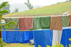 Wet towels on bamboo racks. With mountain view Royalty Free Stock Image