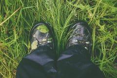 Wet trekking boots Stock Photography