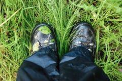 Wet trekking boots Royalty Free Stock Image