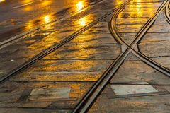 Wet trolley rails in the night Stock Images