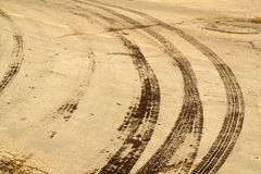 Wet tyre tracks on dirty asphalt road. Abstract background and pattern Stock Photo
