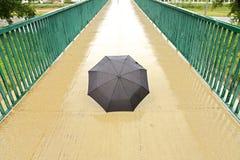 Wet umbrella Stock Images