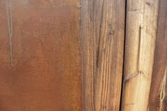 Wet wall of wooden planks pieces of rusty sheet of iron Stock Images