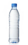 Wet water bottle. Wet plastic water bottle on a white background Royalty Free Stock Images