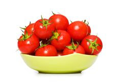 Wet whole tomatos. Arranged isolated on white Royalty Free Stock Image