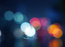 Wet window with background of night city Stock Photos