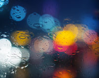 Wet window with background of night city Royalty Free Stock Photo