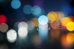 Wet window with background of night city Royalty Free Stock Photography
