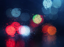 Wet window with background of night city Stock Photography