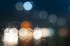 Wet window with background of night city Stock Images