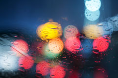 Wet window with background of night city Stock Image