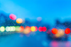 Wet window with background of night city Royalty Free Stock Image