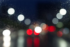 Wet window with background of night city Stock Photo