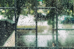 Wet window in drops during the summer rain Royalty Free Stock Photos