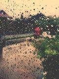 Wet window in rainy season Royalty Free Stock Images