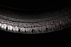 Wet winter tire Stock Photo
