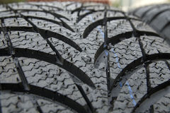 Wet winter tyre Royalty Free Stock Image