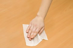 Wet wipe kithchen cleaning. Hand with white wet wipe kithchen cleaning Royalty Free Stock Photo
