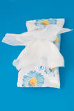 Wet wipes. Antibacterial wet wipes on a blue background stock photos