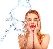 Wet woman face with water drop. Royalty Free Stock Images