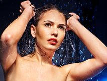 Wet woman face with water drop. Stock Image