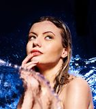 Wet woman face with water drop. Stock Photography