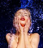 Wet woman face with water drop. Royalty Free Stock Image
