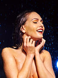 Wet woman face with water drop. Stock Photos