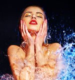 Wet woman face with water drop. Royalty Free Stock Photos