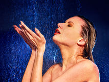 Wet woman face with water drop Stock Images