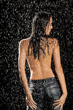 Wet woman in jeans Royalty Free Stock Photography