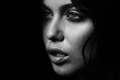 Wet woman portrait with water drops on the face. Black and white Stock Photo
