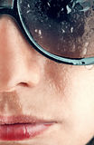 Wet woman's face. Wet woman face closeup in sunglasses Stock Images