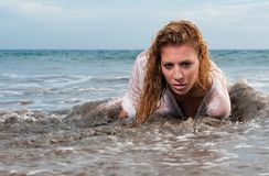 Wet woman on the seaside Royalty Free Stock Photo