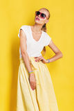 Wet woman in sunglasses and yellow skirt Royalty Free Stock Photo