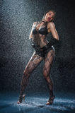 Wet woman in underwear dancing Royalty Free Stock Photography