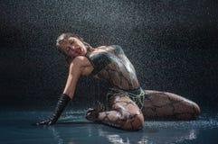 Wet woman in underwear dancing. In a studio Stock Photos