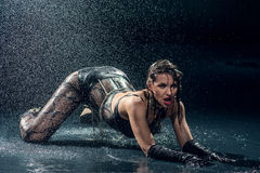 Wet woman in underwear dancing Stock Images