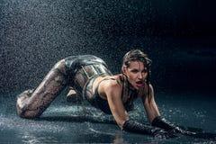Wet woman in underwear dancing. In a studio Stock Images