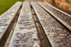 Wet wood bench after rain close-up stock photography