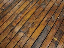 Wet wood planks - 1. Deck flooring made of wood planks, wet after the rain and shown diagonally stock images